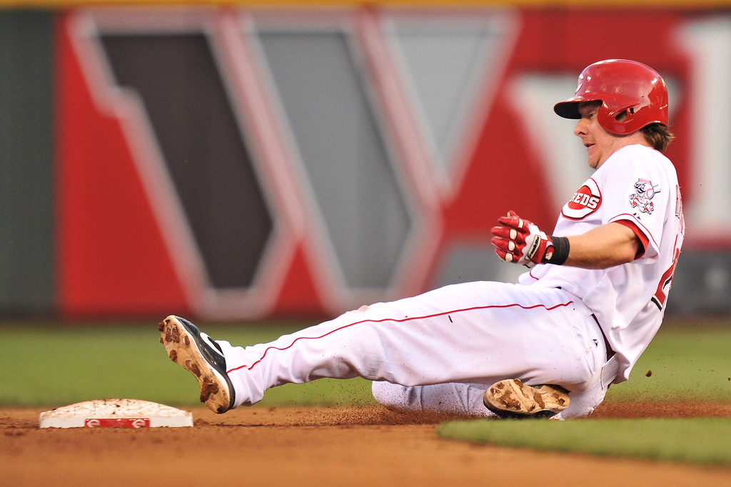 . Ryan Hanigan #29 of the Cincinnati Reds slides in safely to second base for a RBI double in the fourth inning against the Colorado Rockies at Great American Ball Park on June 4, 2013 in Cincinnati, Ohio.  (Photo by Jamie Sabau/Getty Images)