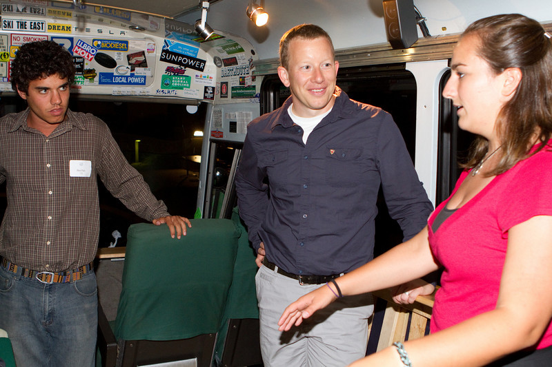 Dorian West (Tesla's Director of Battery Engineering), tours the Big Green Bus with the crew alongside.