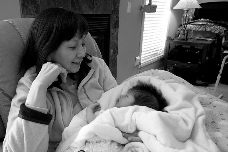 Cly's Mom (new Grandma) watching Julia sleep.