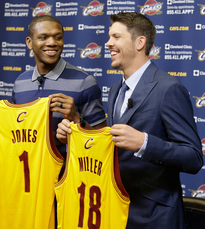 . Cleveland Cavaliers\' James Jones, left, and Mike Miller hold up their jersey\'s after being introduced to the media at an NBA basketball news conference Wednesday, Aug. 6, 2014, in Independence, Ohio. (AP Photo/Tony Dejak)
