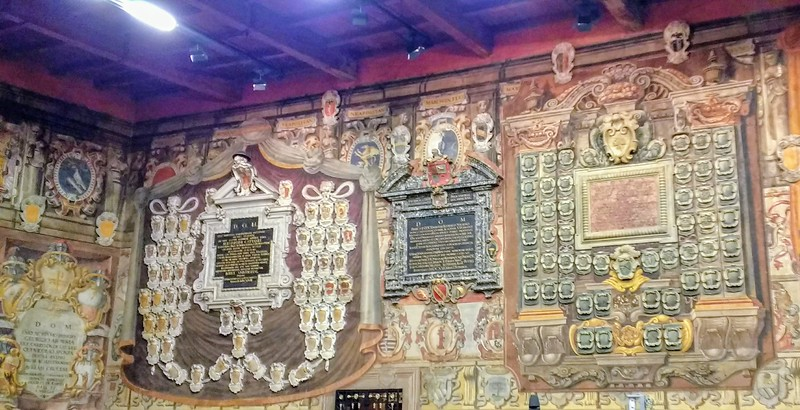 interior space with coats of arms at Europe's oldest university in Bologna, Italy.