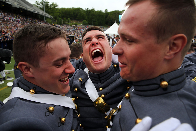 . Cadets celebrate after tossing their hats in the air the conclusion of the graduation ceremony at the U.S. Military Academy at West Point on May 28, 2014 in West Point, New York. U.S. President Barack Obama gave the commencement address at the graduation ceremony. In a highly anticipated speech on foreign policy, the President provided details on his plans for winding down America\'s military commitment in Afghanistan and on future military threats to the United States. Over 1,000 cadets were expected to graduate from the class of 2014 and will be commissioned as second lieutenants in the U.S. Army.  (Photo by Spencer Platt/Getty Images)