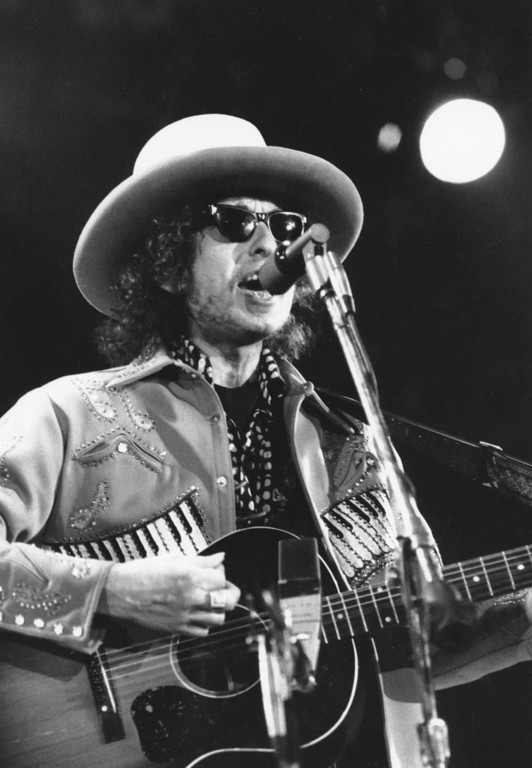 . Singer and guitar player Bob Dylan performs in the Houston Astrodome in Houston, Tex., on Jan 25, 1975.  (AP Photo)