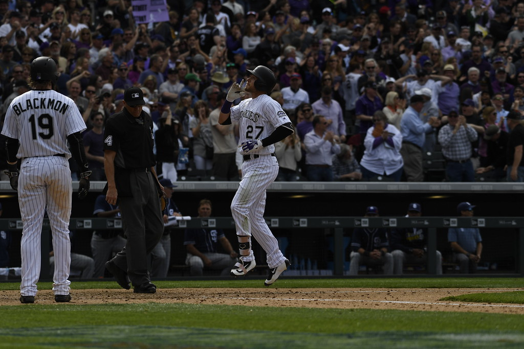 . Trevor Story (27) of the Colorado Rockies crosses home plate after hitting a home run in the fourth inning. The Colorado Rockies played the San Diego Padres Friday, April 8, 2016 on opening day at Coors Field in Denver, Colorado. (Photo By Andy Cross/The Denver Post)