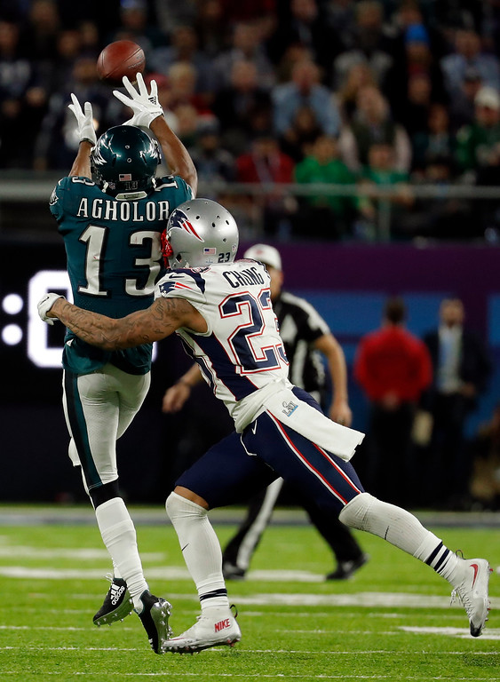 . Philadelphia Eagles wide receiver Nelson Agholor (13) makes a catch against New England Patriots strong safety Patrick Chung (23), during the second half of the NFL Super Bowl 52 football game, Sunday, Feb. 4, 2018, in Minneapolis. (AP Photo/Charlie Neibergall)