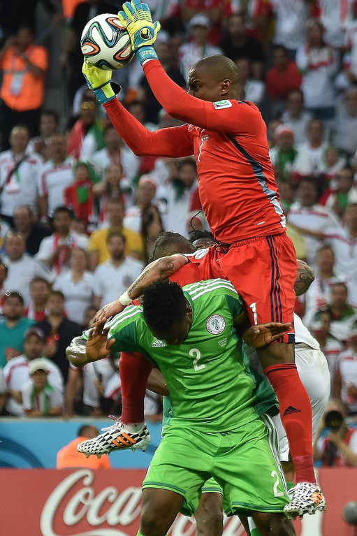 . Nigeria\'s goalkeeper Vincent Enyeama jumps to catch the ball during the Group F football match between Iran and Nigeria at the Baixada Arena in Curitiba during the 2014 FIFA World Cup on June 16, 2014.   LUIS ACOSTA/AFP/Getty Images