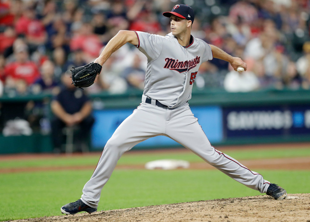. Minnesota Twins relief pitcher Taylor Rogers delivers in the seventh inning of a baseball game against the Cleveland Indians, Wednesday, Aug. 29, 2018, in Cleveland. (AP Photo/Tony Dejak)