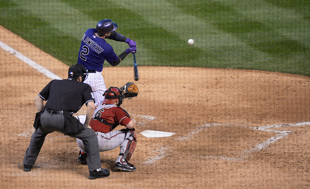 . Colorado Rockies shortstop Troy Tulowitzki (2) hits a double driving in one in the 5th inning against the Arizona Diamondbacks June 4, 2014 at Coors Field. (Photo by John Leyba/The Denver Post)