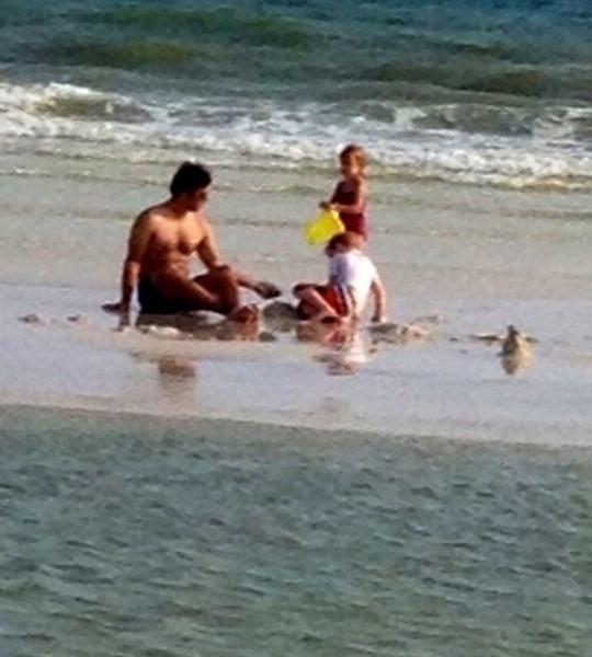 Todd  on the sandbar with Thal and Jackson.