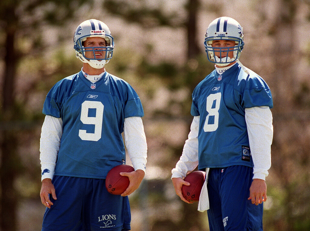 . Detroit Lions quarterbacks Jim Harbaugh (left,#9) and Mike McMahon (#8) take a breather during the Lions morning session of mini camp, Friday, April 27, 2001, at the Lions practice facility in Pontiac, Mich.