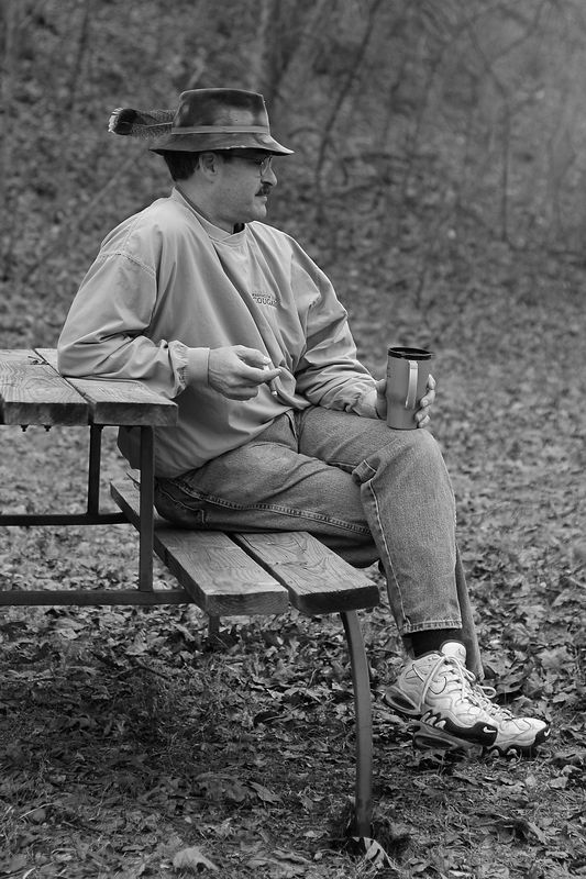 Ross enjoying a cigar and a cup of coffee.