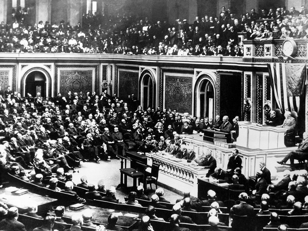 Description of . President Woodrow Wilson delivers a declaration of war to the joint session of Congress, in Washington, April 2, 1917. (AP Photo)