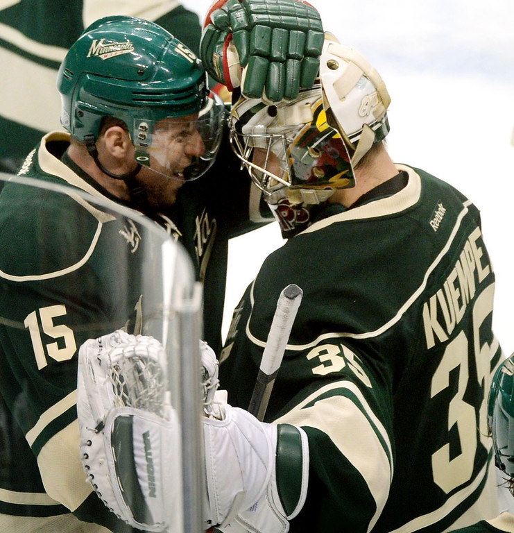 . Minnesota Wild goalie Darcy Kuemper and teammate Dany Heatley celebrate the 5-2 win over the Colorado Avalanche. (Pioneer Press: Sherri LaRose-Chiglo)