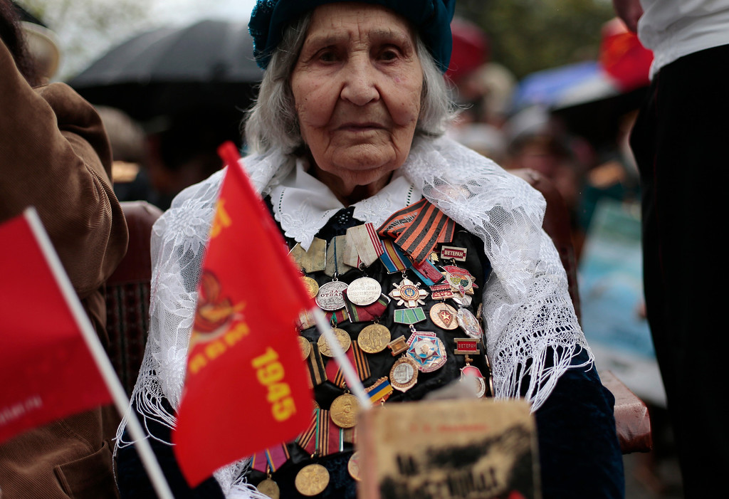 . A WWII veteran attends a Victory Day military parade in Sevastopol, Crimea, Friday, May 9, 2014. (AP Photo/Ivan Sekretarev)