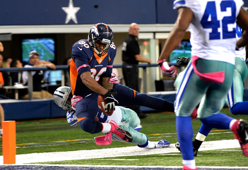 . Tight end Julius Thomas #80 of the Denver Broncos trying to get into the end zone in the fourth quarter against the Dallas Cowboys in game 5 at AT&T Stadium October 06, 2013 Arlington, Texas. (Photo By Joe Amon/The Denver Post)