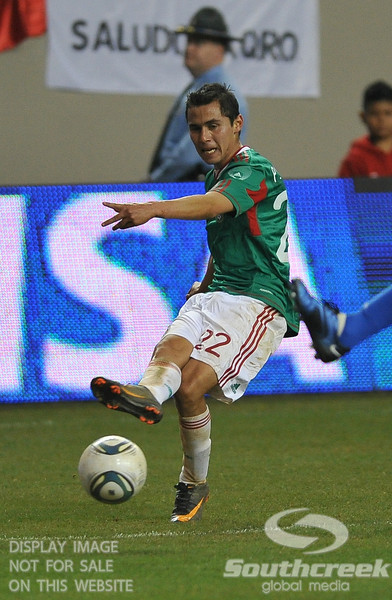 Mexico's Defender Paul Aguilar (#22) passes the ball in Soccer action between Bosnia-Herzegovina and Mexico.  Mexico defeated Bosnia-Herzegovina 2-0 in the game at the Georgia Dome in Atlanta, GA.