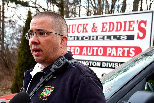 3/19/2019 Mike Orazzi | Staff Southington Fire Department Battalion Chief Eric Heath talks about a car fire at Chuck & Eddie's Used Auto Parts on Old Turnpike Rd, Southington Tuesday afternoon.