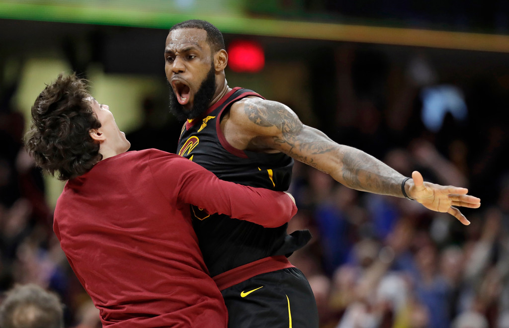 . Cleveland Cavaliers\' LeBron James, right, celebrates with Cedi Osman, from Turkey, after James shot a game-winning three point shot in the second half of Game 5 of an NBA basketball first-round playoff series, Wednesday, April 25, 2018, in Cleveland. The Cavaliers won 98-95. (AP Photo/Tony Dejak)
