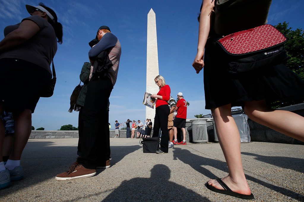 . Visitors line up for tickets which are distributed at on a first-come basis at the Washington Monument in Washington, Monday, May 12, 2014, ahead of a ceremony to celebrate its re-opening.  (AP Photo)
