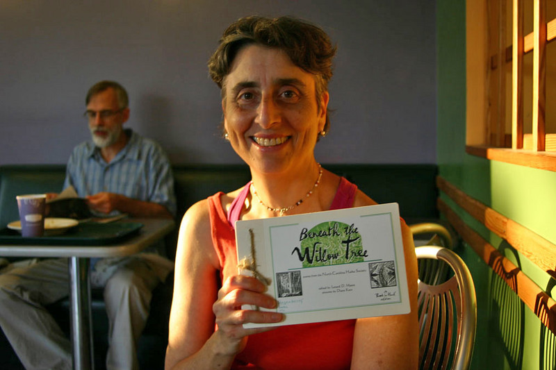 Diane Katz of Rosenberry Books at Weaver Street Market in Carrboro, North Carolina. Diane designed the book and created the illustrations. That's the Standard Edition of the book she is holding.   For details about the book and how to order, see the Books by Members section of the North Carolina Haiku Society Web site:  http://www.nc-haiku.org/books.htm#ncbooks