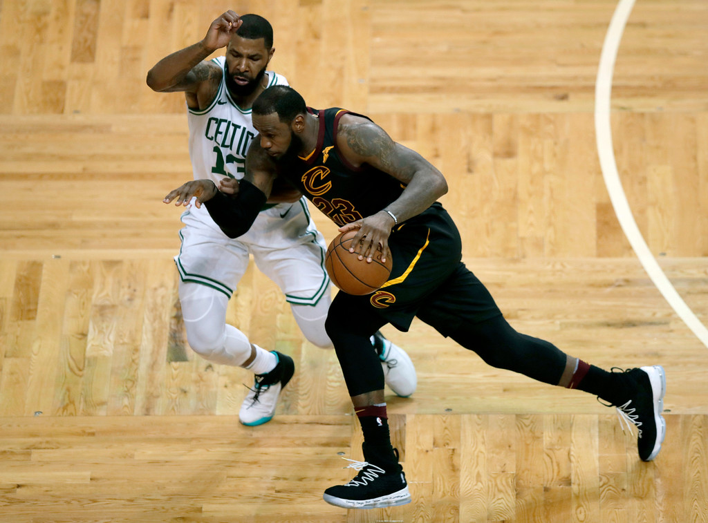 . Cleveland Cavaliers forward LeBron James (23) drives against Boston Celtics forward Marcus Morris (13) during the second half in Game 7 of the NBA basketball Eastern Conference finals, Sunday, May 27, 2018, in Boston. (AP Photo/Charles Krupa)