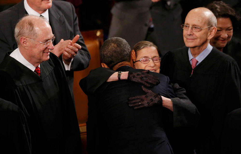 Description of . U.S. Supreme Court Justice Ruth Bader Ginsburg hugs President Barack Obama as fellow Supreme Court Justices Anthony Kennedy (L) and Stephen Breyer (R) look on as the President arrives to deliver his State of the Union speech on Capitol Hill in Washington, February 12, 2013.  REUTERS/Jason Reed