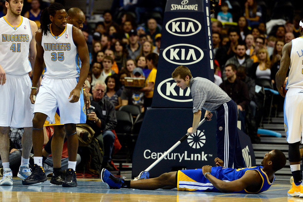 . Denver Nuggets small forward Kenneth Faried (35) looks down after being fouled by Golden State Warriors small forward Harrison Barnes (40) during the first half at the Pepsi Center on Sunday, January 13, 2013. AAron Ontiveroz, The Denver Post