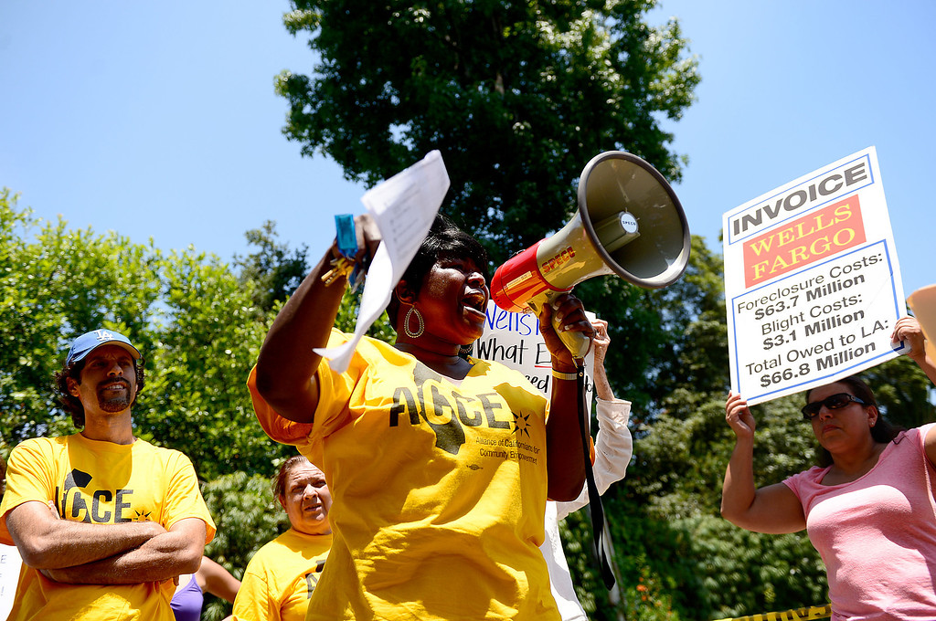 . Peggy Mears, of ACCE, speaks as protesters descend on the home of Timothy Sloan, chief financial officer of Wells Fargo, in San Marino to protest foreclosures Saturday, July 27, 2013. (SGVN/Staff Photo by Sarah Reingewirtz)