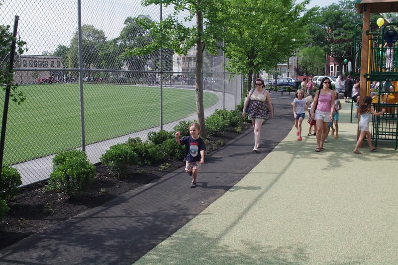 Anya runs into the new playground.