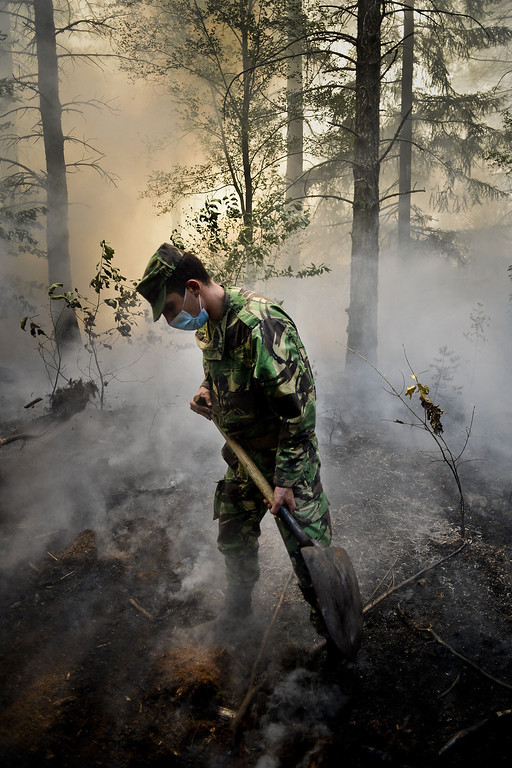 . A Portuguese soldier helps combat a wildfire around Caramulo, central Portugal, on August 30, 2013.   AFP PHOTO / PATRICIA DE MELO MOREIRA/AFP/Getty Images