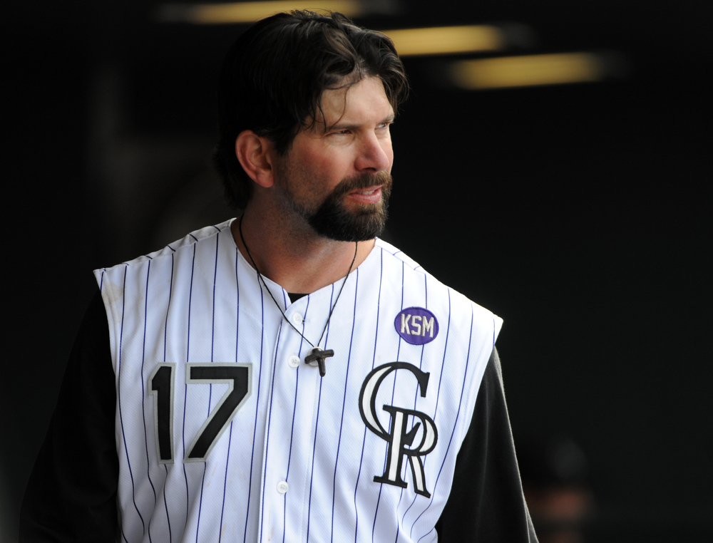 . Colorado Rockies\' Todd Helton looks on against the Arizona Diamondbacks during the sixth inning of an MLB baseball game in Denver, Sunday, Sept. 12, 2010. (AP Photo/Jack Dempsey)