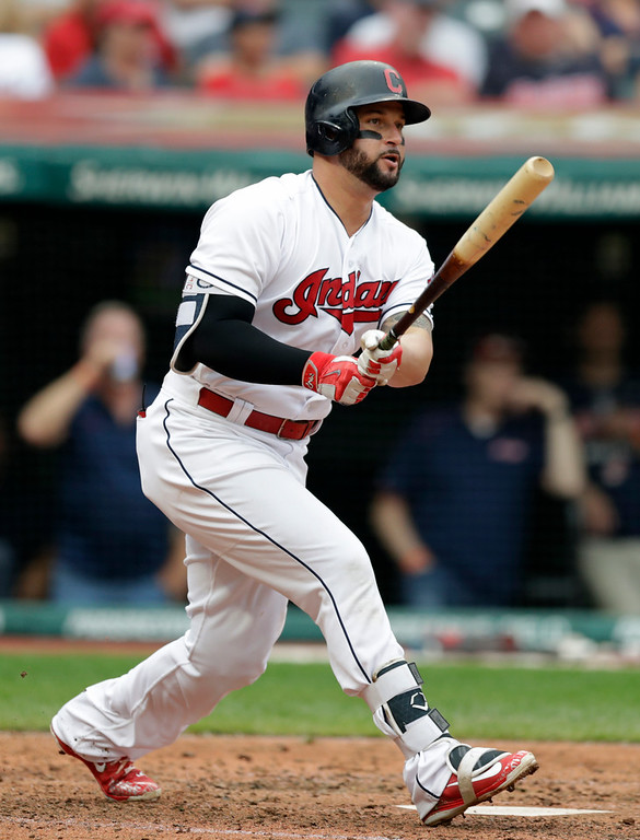 . Cleveland Indians\' Yonder Alonso watches his ball after hitting a one-run double off Chicago White Sox starting pitcher Reynaldo Lopez in the fifth inning of a baseball game, Wednesday, June 20, 2018, in Cleveland. Jose Ramirez scored on the play. (AP Photo/Tony Dejak)