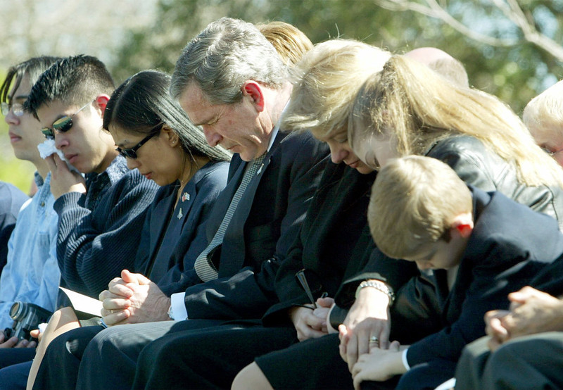 . President Bush and the families of the astronauts pray Tuesday, Feb. 4, 2003, at the NASA\'s Johnson Space Center, in Houston, during a memorial service for the seven astronauts who perished in the space shuttle Columbia disaster over the skies of Texas .  President Bush and first lady Laura Bush sat with the families of Rick Husband, right, and William McCool, left.   (AP Photo/Pablo Martinez-Monisvais)