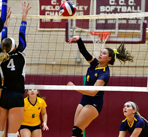 11/14/2018 Mike Orazzi | Staff Bristol Eastern's Olivia Beaudoin (4) and Woodstock Academy's Paula Hernandez Aulet (9) during the Class L Semifinal State Girls Volleyball Tournament held at Windsor High School Wednesday night.