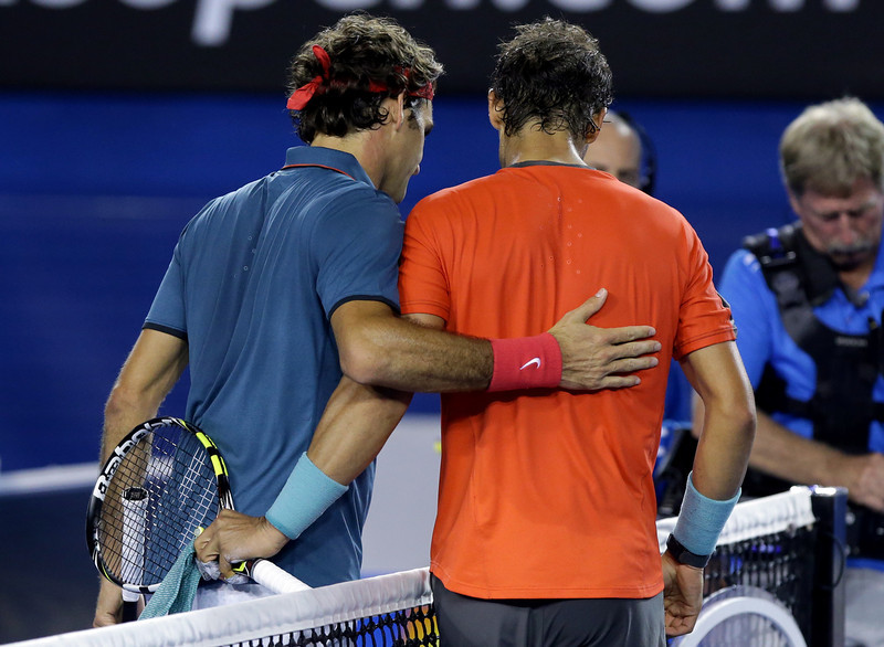 . Rafael Nadal of Spain, right, is congratulated by Roger Federer of  Switzerland at the net after Nadal won their semifinal at the Australian Open tennis championship in Melbourne, Australia, Friday, Jan. 24, 2014.(AP Photo/Aaron Favila)