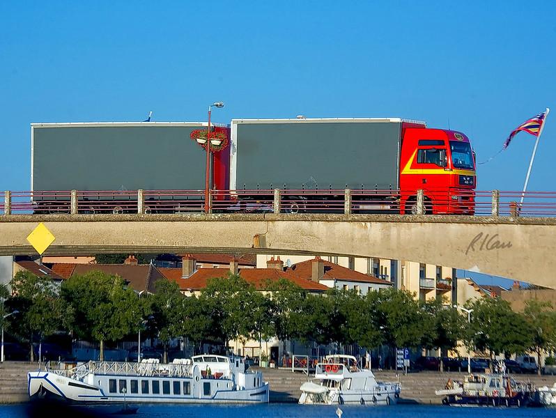 Man truck pulls dual/two trailers over Soane River Bridge at St Jean de Losne, France September 2006