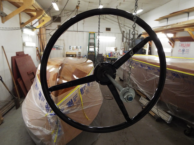 Steering wheel repaired and refinished.