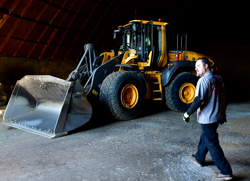1/17/2019 Mike Orazzi | Staff Frank Nicastro Jr. while loading a salt mixture into truck at the Bristol Public Works garage on Vincent P Kelly Road Thursday.