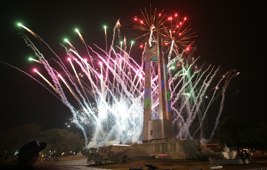 . Fireworks begin during a New Year\'s eve countdown at the Quezon Memorial Circle in suburban Quezon city, north of Manila, Philippines on Wednesday, Dec. 31, 2014. (AP Photo/Aaron Favila)