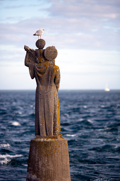 Statue on the sea, Kerpenhir point, town of Locmariaquer, departament of Morbihan, Brittany, France