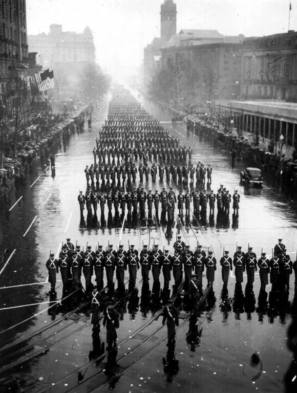 . FILE - Military units splash along in the pouring rain during the inaugural parade of President Franklin D. Roosevelt Jan. 20, 1937 in Washington.  Aides tried to talk  Roosevelt into moving the ceremony indoors but he looked out at the soggy crowd and replied: ``If they can take it, I can take it.\'\'  Mother Nature doesn\'t always frown on presidential inaugurations, but occasional storms have been miserable, even fatal.  (AP Photo, files)