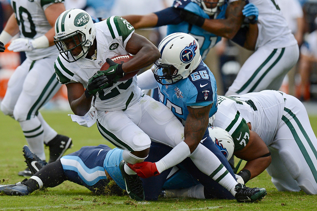 . New York Jets running back Bilal Powell (29) is brought down by Tennessee Titans linebacker Zach Brown (55) in the first quarter of an NFL football game on Sunday, Sept. 29, 2013, in Nashville, Tenn. (AP Photo/Mark Zaleski)
