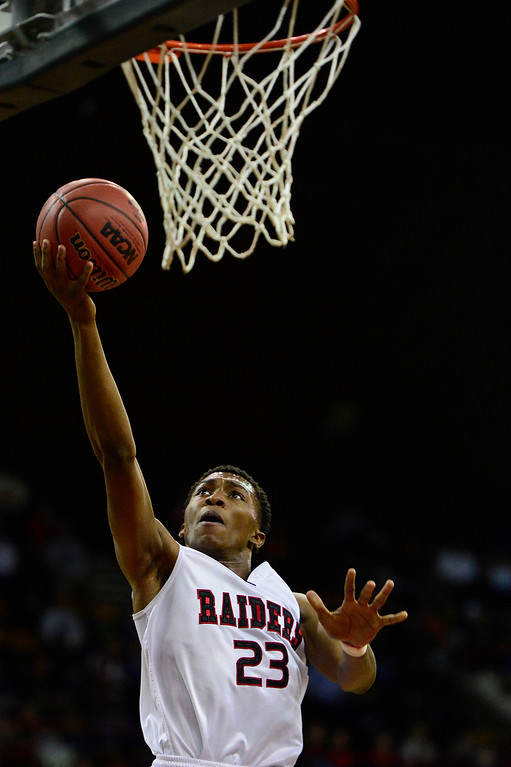 . Rangeview center Elijah Reed (23) goes for a layup during the second quarter at the Denver Coliseum on March 5, 2016 in Denver, Colorado. Rangeview defeated Cherokee Trail 75-64 to advance to the semifinals in the Class 5A Colorado state basketball tournament. (Photo by Brent Lewis/The Denver Post)