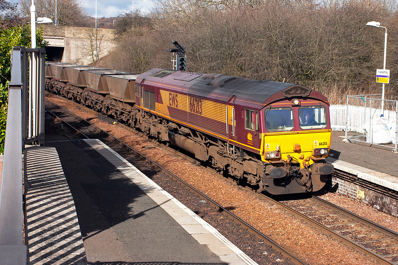 /In lovely spring sunshine 66213 runs through Inverkeithing station with what turned out to be a long rake of 40 empty HAA MGR hoppers running as 6J13 Longannet Power Station to Hunterston.  19/3/2007
