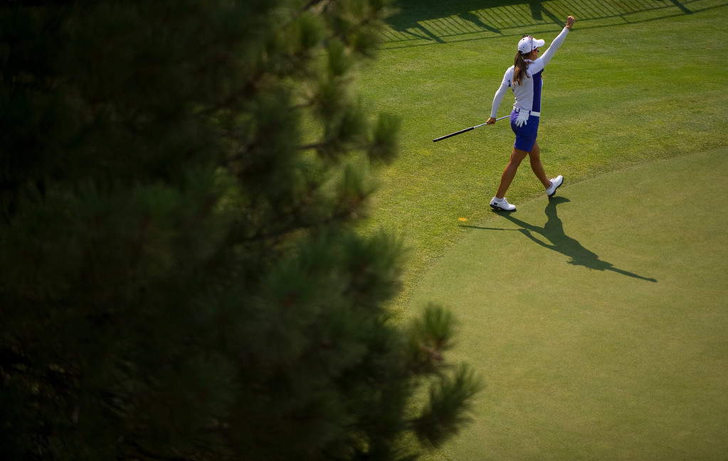 . PARKER, CO - AUGUST 16: European Azahara Munoz celebrates after sinking a long putt on the ninth hole during the first day of the Solheim Cup at Colorado Golf Club, on August 16, 2013.  (Photo By Grant Hindsley/The Denver Post)