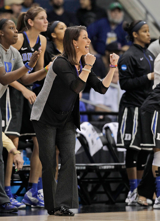 . Duke coach Joanne McCallie cheers on her team during the first half against Notre Dame in the regional final of the NCAA women\'s college basketball tournament Tuesday, April 2, 2013, in Norfolk, Va. (AP Photo/Steve Helber)