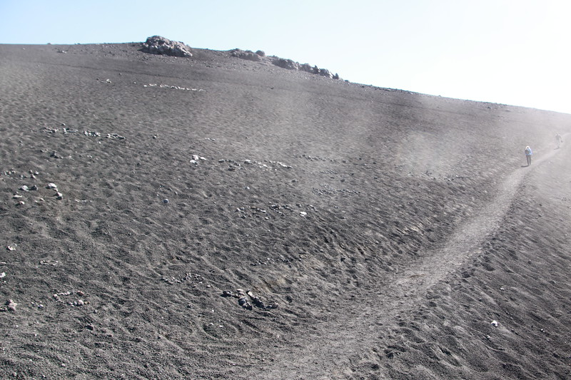 Walking through lava, high on Mt Etna