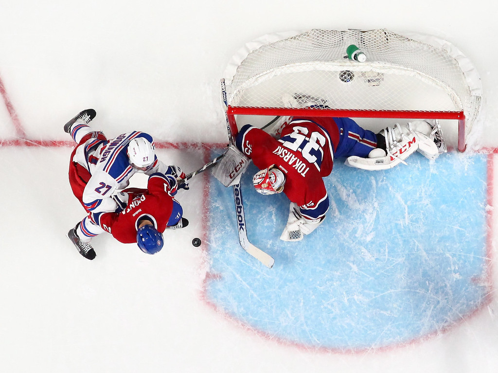 . MONTREAL, QC - MAY 27: Dustin Tokarski #35 of the Montreal Canadiens defends the net agaisnt Ryan McDonagh #27 of the New York Rangers during Game Five of the Eastern Conference Final in the 2014 NHL Stanley Cup Playoffs at Bell Centre on May 27, 2014 in Montreal, Canada. Canadiens defeated the Rangers 7-4.  (Photo by Francois Laplante/FreestylePhoto/Getty Images)