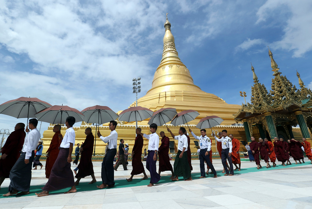 . Buddhist monks walk around the Uppatasanti Pagoda during celebrations of the full moon day of Thadingyut, or lighting festival, to mark the end of Buddhist Lent, Thursday, Oct 5, 2017, in Naypyitaw, Myanmar. Thadingyut is held every year in October in Myanmar, a predominantly Buddhist country. (AP Photo/Aung Shine Oo)