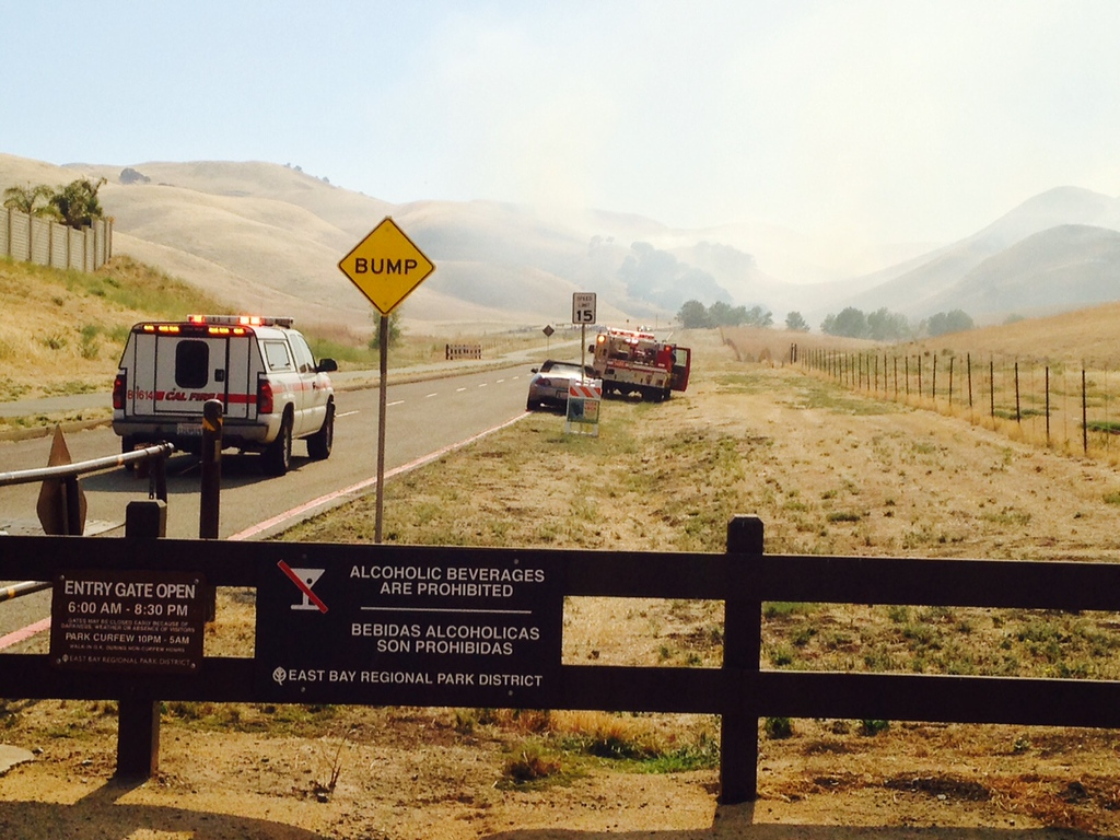 . Fire crews arrive at a vegetation fire at Contra Loma Reservoir in Antioch, Calif., on Wednesday, June 24, 2015. More than 100 acres have burned in the hills near Contra Loma Regional Park and Black Diamond Regional Preserve on Wednesday afternoon, a Contra Costa fire dispatcher said. (Susan Tripp Pollard/Bay Area News Group)